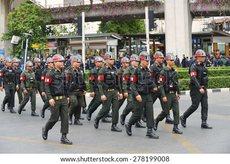 BANGKOK - MAY 30: Military police deploy on a city centre street following a military coup on May 30, 2014 in Bangkok, Thailand. The Thai capital is under martial law after Thailand's 19th coup.