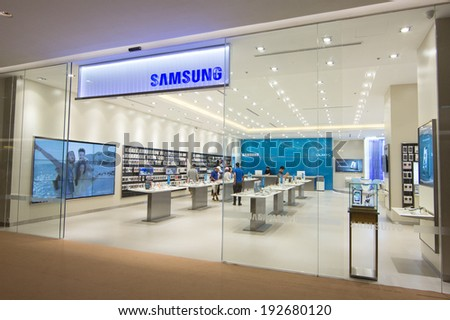 BANGKOK - MAY 13: People shop at Samsung mobile shop at Central Embassy on May 13, 2014. It is a South Korean multinational conglomerate company. - stock photo