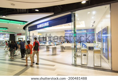 BANGKOK - MAY 29 :People shop at Samsung mobile shop at Central Rama 9, Bangkok on May 29, 2014. It is a South Korean multinational conglomerate company. - stock photo