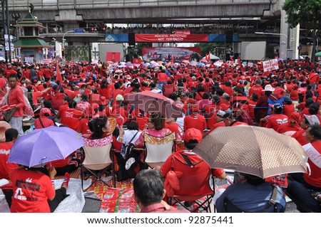 BANGKOK - MAY 19: Red-shirt protesters gather at Ratchaprasong Junction to mark a year since 91 people died in violent anti-government clashes in the Thai capital on May 19, 2011 in Bangkok, Thailand. - stock photo