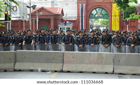 BANGKOK - MAY 31: Riot police form a line outside Thai Parliament during a political rally on May 31, 2012 in Bangkok, Thailand. Protesters rallied in opposition to a proposed reconciliation bill. - stock photo