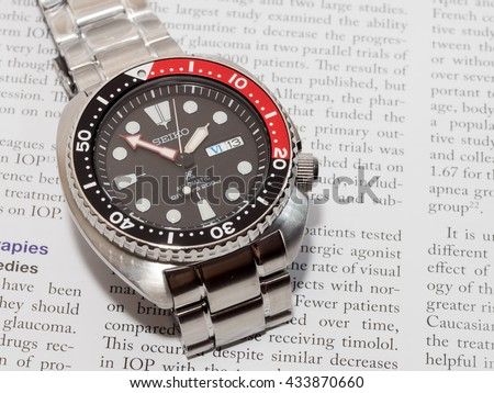 BANGKOK - MAY 31: Seiko Prospex diver black dial, red and black bezel watch with stainless steel, turtle model,  was taken on May 31, 2016, in Bangkok, Thailand.