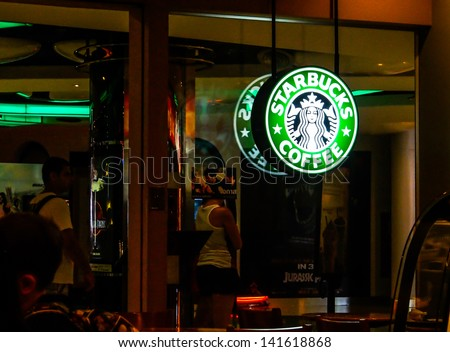 BANGKOK - MAY 24: Starbucks coffee shop in MBK center on May 24, 2013 in Bangkok, Thailand. Starbucks Corporation is an American global coffee company which has 171 branches in Thailand. - stock photo