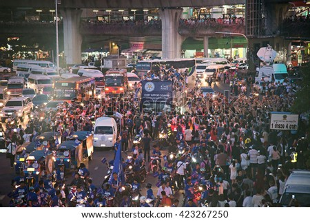 Bangkok, 19 MAY 2016, Thailand people lined the streets Victory Monument to watch Leicester City parade on open-top buses in celebration of their Premier League title win. (with noise and gain) - stock photo