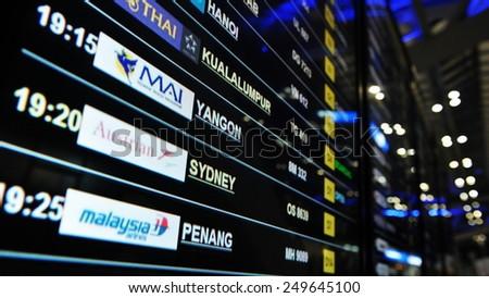 BANGKOK - MAY 9: View of a arrival and departures board at Suvarnabhumi International Airport on May 9, 2013 in Bangkok, Thailand. The SE Asia aviation hub handles 45 million passengers annually.  - stock photo
