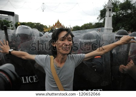 BANGKOK - NOV 24: A  protester from the nationalist Pitak Siam confronts riot police during a violent anti-government rally on Nov 24, 2012 in Bangkok, Thailand.