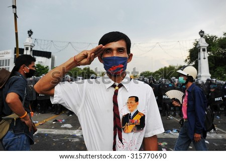 BANGKOK - NOV 24: A protester from the nationalist Pitak Siam joins an anti government rally on Nov 24, 2012 in Bangkok, Thailand. Violent clashes with police erupted during the rally. - stock photo