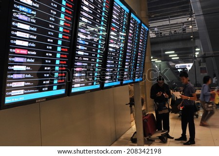 BANGKOK - NOV 28: A view of a departures board at Suvarnabhumi International Airport on Nov 28, 2012 in Bangkok, Thailand. Thailand's main airport handles 45 million passengers annually.  - stock photo