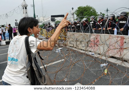 BANGKOK - NOV 24: An unidentified protester from the nationalist Pitak Siam group shouts abuse at a police barricade during a large anti government rally on Nov 24, 2012 in Bangkok, Thailand.