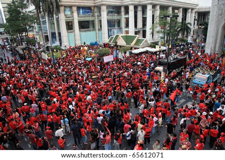 BANGKOK - NOV 19: At least 10,000 Red Shirts anti-government protesters return to Bangkok's streets to mark 6 month anniversary of a deadly military crackdown on Nov 19, 2010 in Bangkok.