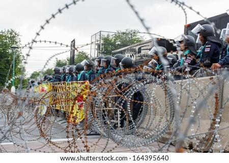 Bangkok-Nov 25:Confront and clash between police and anti-government protesters at sriayudhaya road on Nov 25,2013 in Bangkok,Thailand - stock photo