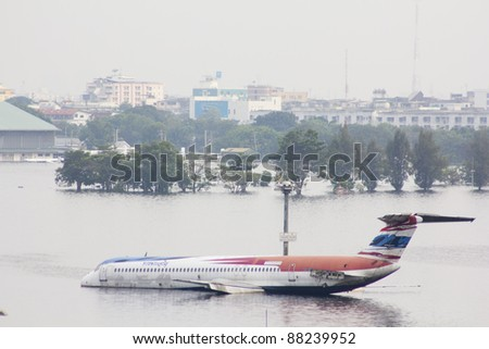 BANGKOK-NOV 5:Flood hits Bangkok areas around Tollway, higher water levels than expected,aircraft affected by flood on November 5, 2011 on vibhavadee Rd,Thailand ( Donmuang Airport) - stock photo