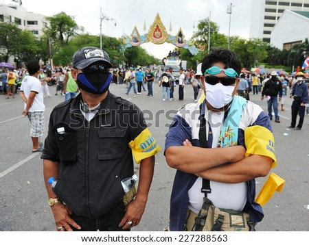 BANGKOK - NOV 24: Masked protesters attend a violent anti-government rally organized by the nationalist Pitak Siam group on Nov 24, 2012 in Bangkok, Thailand.