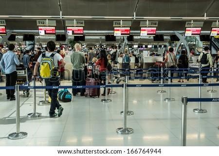 BANGKOK-NOV 30:Passengers arrive at check-in counters at Suvarnabhumi International Airport on November 30,2013 in Bangkok,Thailand.This airport is handling about 45 million passengers annually. - stock photo