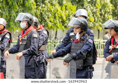 BANGKOK - NOV 13: Riot police stand guard near parliament during anti-government rally on Nov 13, 2013 in Bangkok, Thailand. Protests surrounding an amnesty bill