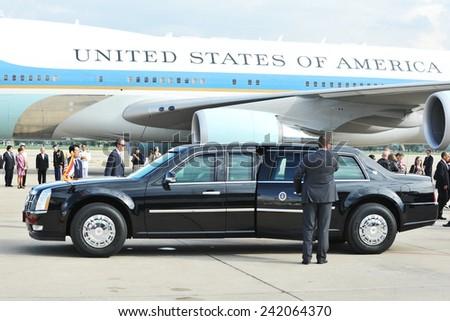 BANGKOK - NOV 18: US Presidential State Car waits by Air Force One on tarmac at Don Muang International Airport as President Barack Obama begins a SE Asia tour on Nov 18, 2012 in Bangkok, Thailand.  - stock photo