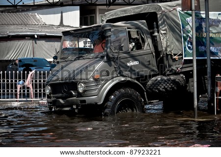 BANGKOK - NOVEMBER 1: A military truck gets stuck in the middle of the evacuate mission from the flooded area in the Rama - Indra road during the massive flood crisis on November 1, 2011 in Bangkok.
