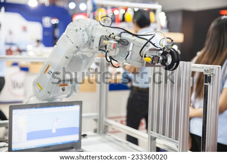 BANGKOK - NOVEMBER 22 :An industrial robot hands display at METALEX 2014 on Nov 22,2014 in BITEC ,Bangkok, Thailand. - stock photo