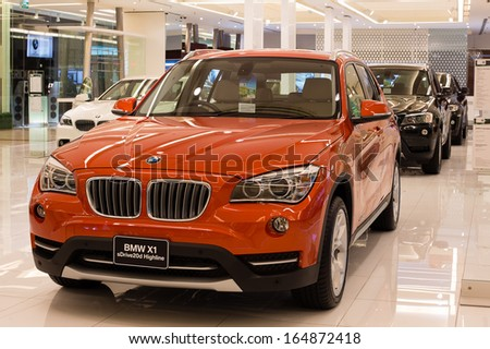 BANGKOK - NOVEMBER 19: BMW X1 xDrive 20d car on display at the Siam Paragon Mall on Nov 19, 2013 in Bangkok, Thailand. Siam Paragon is a one of the biggest shopping centres in Asia. - stock photo