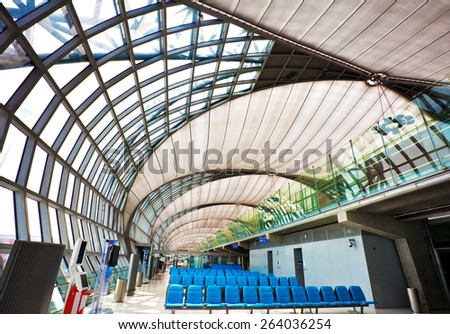 BANGKOK - NOVEMBER 8, 2009 5: Futuristic interior of Suvarnabhumi airport in Bangkok, Thailand. Airport is 18th busiest in the world (by passenger traffic), was opened on Sept. 28, 2006 - stock photo