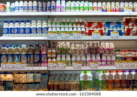 BANGKOK - NOVEMBER 18: Selection of yogurts, soy milk and milk on the shelves in a supermarket Siam Paragon on November 18, 2013 in Bangkok, Thailand. - stock photo