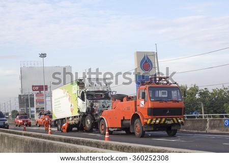 BANGKOK - November 14, 2015: Staff clearing an accident cars crash on expressway - stock photo