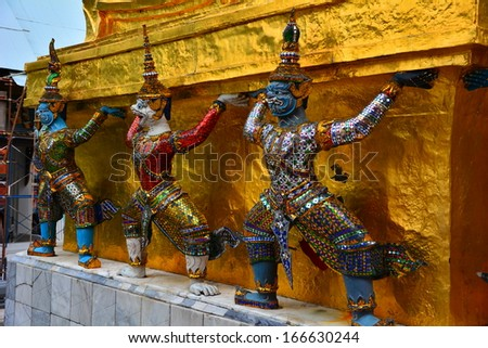 BANGKOK - 17 November 2013: The demon guardians supporting the Golden Pagoda at Wat Phra Kaew, Temple of Emerald Buddha in Grand Palace, the iconic landmark in Bangkok, Thailand