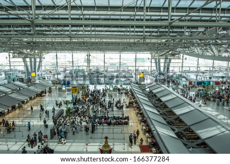 BANGKOK -NOVEMBER 30:The departure terminal of Bangkok Suvarnabhumi International Airport on November 30, 2013 in Bangkok, Thailand.This airport is handling about 45 million passengers annually. - stock photo