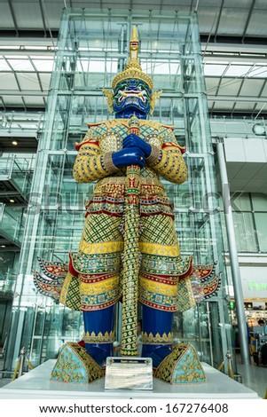 BANGKOK -NOVEMBER 30:The giant statue in the departure terminal of Bangkok Suvarnabhumi International Airport on November 30, 2013 in Bangkok, Thailand. - stock photo