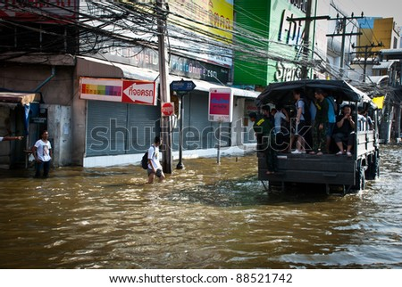 BANGKOK - NOVEMBER 7 : Unidentified group of victims are riding a truck after impact with heaviest flood and rain in 20 years in the capital on November 07, 2011 in Bangkok, Thailand.