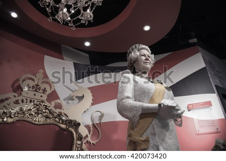 BANGKOK - OCT 28: A waxwork of Her Majesty Queen Elizabeth II on display at Madame Tussauds on Oct 28, 2015 in Bangkok, Thailand. Madame Tussauds' newest branch hosts waxworks of numerous celebrities.