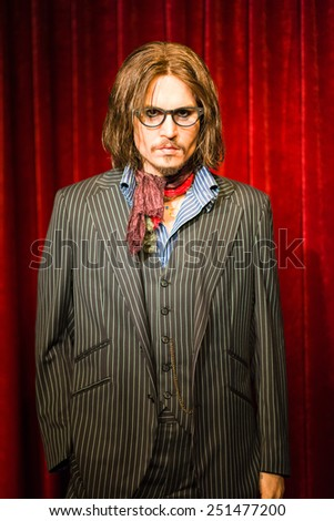 BANGKOK - OCT 21: A waxwork of Johnny Depp on display at Madame Tussauds on Oct 21, 2012 in Bangkok, Thailand. Madame Tussauds' newest branch hosts waxworks of numerous stars and celebrities. - stock photo