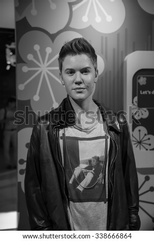 BANGKOK - OCT 28: A waxwork of Justin Bieber on display at Madame Tussauds on October 28, 2015 in Bangkok, Thailand. Madame Tussauds' newest branch hosts waxworks of numerous stars and celebrities.