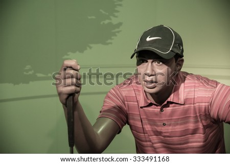 BANGKOK - OCTOBER 28: A waxwork of Tiger Woods on display at Madame Tussauds on October 28, 2015 in Bangkok, Thailand. Madame Tussauds' newest branch hosts waxworks of numerous stars and celebrities. - stock photo