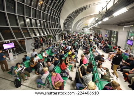 BANGKOK -OCTOBER 17: 2014: passengers wait for the plane at  the  Suvarnabhumi Airport, October 17, 2014 in Bangkok, Thailand.The airport is handling about 45 million passengers annually. - stock photo