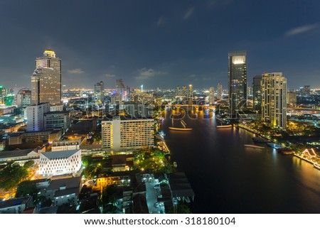 Bangkok river view at night with modern business building along the Chao Phraya river (Thailand)