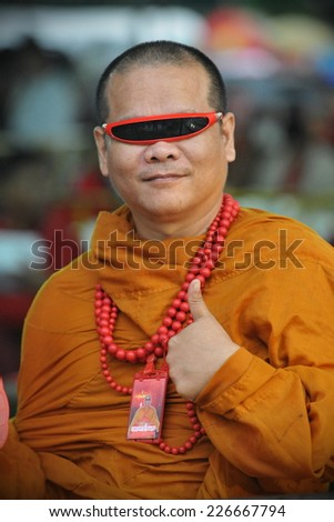 BANGKOK - SEP 15: An unidentified Buddhist monk attends a Red Shirt rally on Sep 15, 2012 in Bangkok, Thailand. The political rally was held to mark the 6th anniversary of a military coup. - stock photo