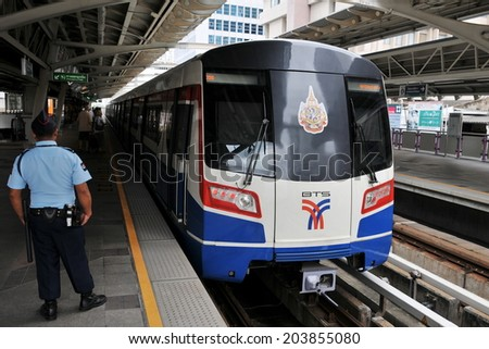 BANGKOK - SEP 12: BTS Skytrain arrives at a city centre station on Sept 12, 2011 in Bangkok, Thailand. Each train of the mass rail network can carry over 1000 passengers.