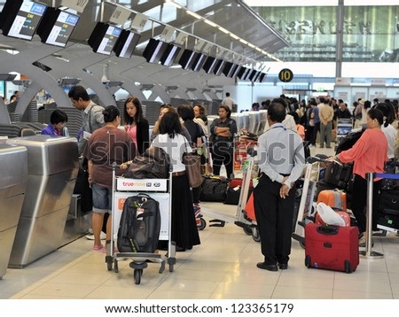 BANGKOK - SEP 19: Passengers arrive at check-in counters at Suvarnabhumi Airport on Sep 19, 2012 in Bangkok, Thailand. The airport handles 45 million passengers annually.