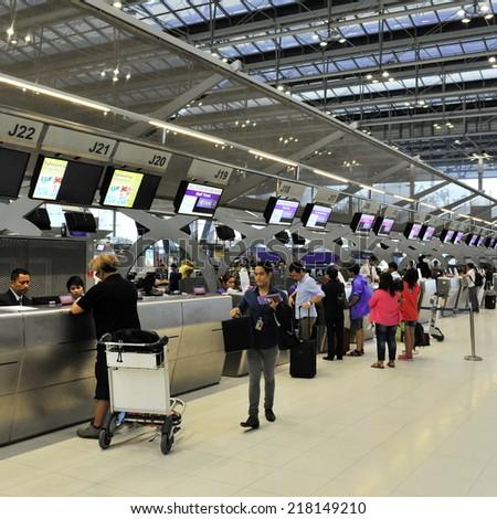 BANGKOK - SEP 19: Passengers arrive at check-in counters at Suvarnabhumi Airport on Sep 19, 2012 in Bangkok, Thailand. The airport handles 45 million passengers annually. - stock photo