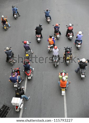 BANGKOK - SEPT 10: Motorcyclists wait at a junction during rush hour on Sept 10, 2012 in Bangkok, Thailand. Motorcycles are often the transport of choice for Bangkok's heavily congested roads.