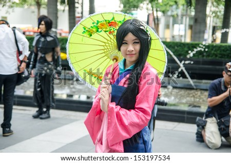 BANGKOK - SEPTEMBER 01 : An unidentified Japanese anime cosplay pose in Japan Festa in Bangkok 2013 on September 01, 2013 at Central World, Bangkok, Thailand
