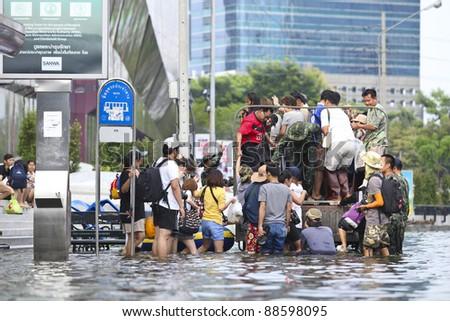 BANGKOK - SEPTEMBER 5: The people wait and take army bus on Sep 5, 2011 in Radplao Junction, Bangkok, Thailand. Thai Flood 2011 - stock photo