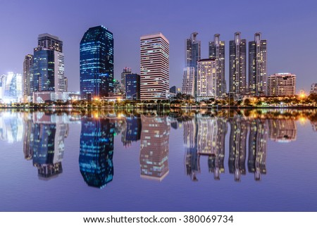 Bangkok skyline and water reflection with urban lake in summer. - stock photo