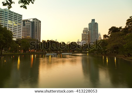 Bangkok skyline from Lumpini Park at the sunset ,Thailand