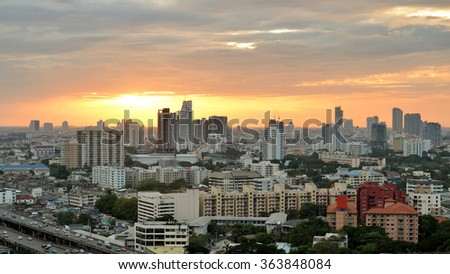 Bangkok skyline with city before sunset - stock photo