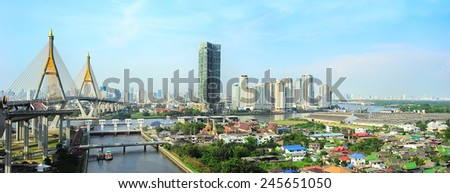 Bangkok skyline with  the Industrial Ring Road Bridge on the left - stock photo