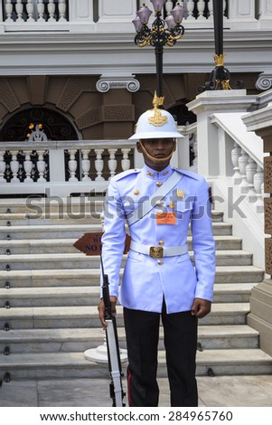 BANGKOK, THAILAND - APR. 22 2014: Kings Guard in Grand Royal Palace (Phra Borom Maha Ratcha Wang) in Bangkok, Thailand. Palace was the residence of Siam Kings, now used for official events - stock photo