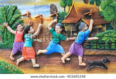BANGKOK ,THAILAND - APR 9 : Stone carving and painting of Traditional Thai culture on temple wall at Wat Dan on April 9, 2016 in Bangkok, Thailand. - stock photo