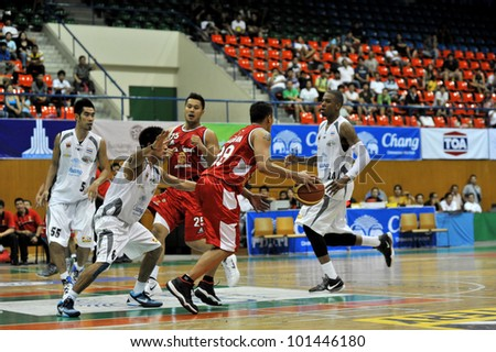 BANGKOK, THAILAND - APR 22 : Unidentified players in action at Asean Basketball League 2012 (ABL) between Slammers vs San Miguel at Thai Japanese Association Gym on April 22, 2012 in Bangkok, Thailand
